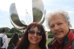 In front of famous flower sculpture
